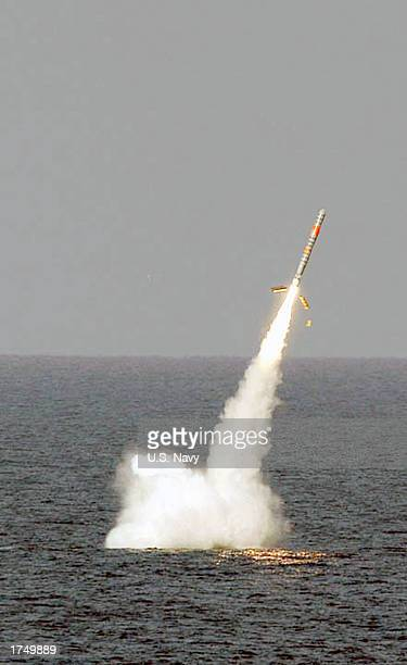 This handout image from the US Navy shows a Tomahawk cruise missile as it launches from the submerged Ohioclass submarine the USS Florida on January...