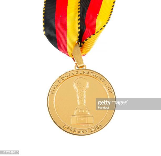 This handout image provided by Julien's Auctions shows a gold tone medal awarded to a player from the champion Brazil national football team, winner...