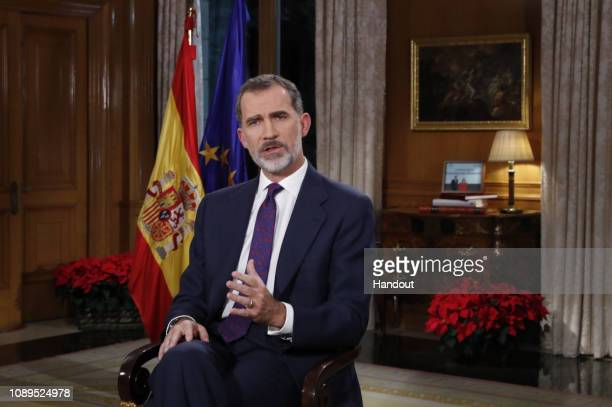 This handout image provided by the Spanish Royal Household shows King Felipe of Spain delivers his Christmas Speech on December 24, 2018 in Madrid,...