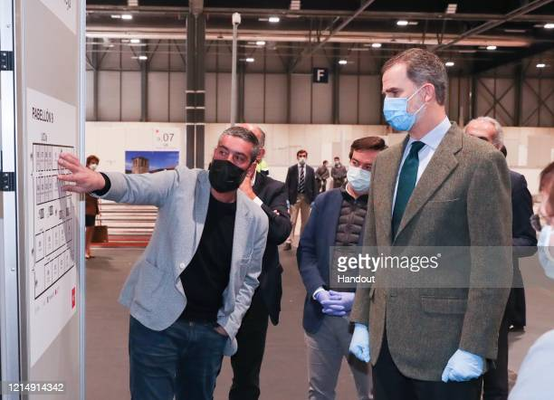 This handout image provided by the Spanish Royal Household shows King Felipe of Spain visiting the emergency hospital at Ifema on March 26, 2020 in...