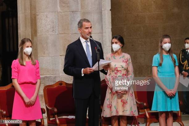 This handout image provided by the Spanish Royal Household shows Princess Leonor, King Felipe of Spain speaking, Queen Letizia of Spain and Princess...