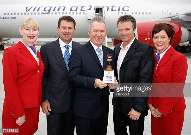 This handout image provided by Virgin Atlantic shows former Australian cricket captains Mark Taylor Allan Border and Steve Waugh pose with a replica...
