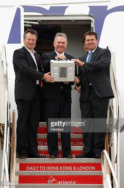 This handout image provided by Virgin Atlantic shows former Australian cricket captains Steve Waugh Allan Border and Mark Taylor stepping off a plane...