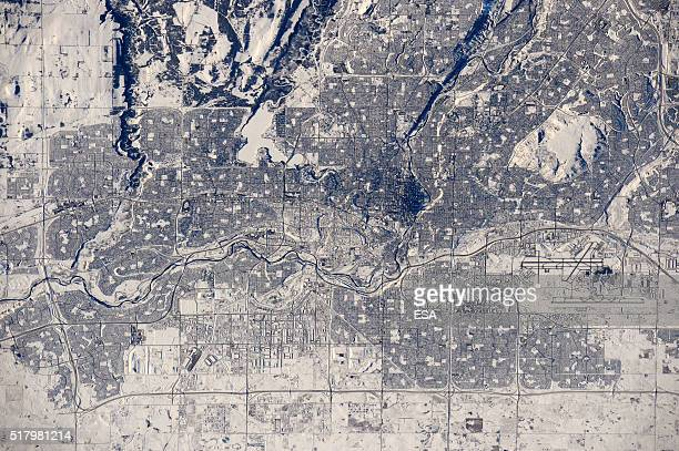This handout image supplied by the European Space Agency shows a view of the city of Calgary Canada in the snow with the Bow River running from left...