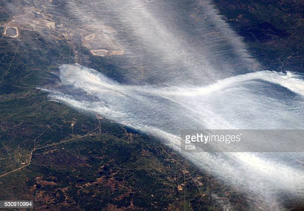 This handout image supplied by the European Space Agency shows smoke from forest fires burning around the area of Fort McMurray in Alberta Canada in...