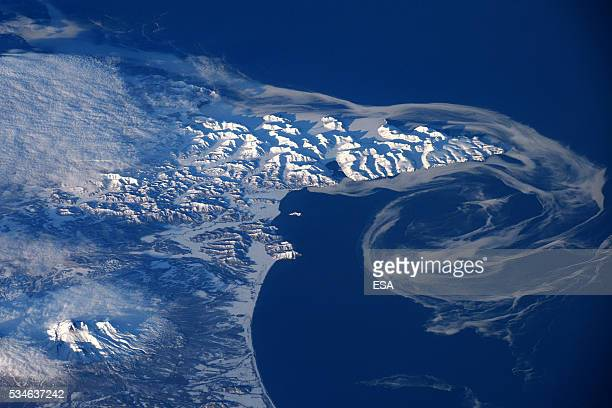 This handout image supplied by the European Space Agency shows the last of the Bering Sea ice melting along the coastline of Russia in an image taken...