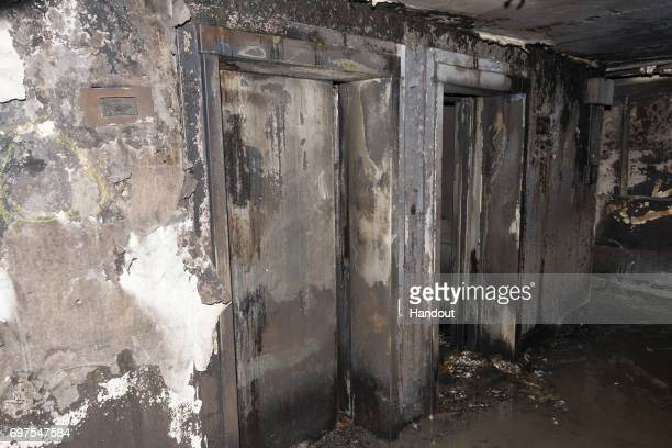 This handout image supplied by the London Metropolitan Police Service on June 18 2017 shows an interior view of fire damaged lifts in Grenfell Tower...