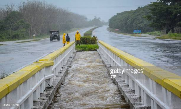 TOPSHOT This handout photo from the Cuban News Agency shows the National Highway cut off at Km 254 by heavy rainfall associated with subtropical...