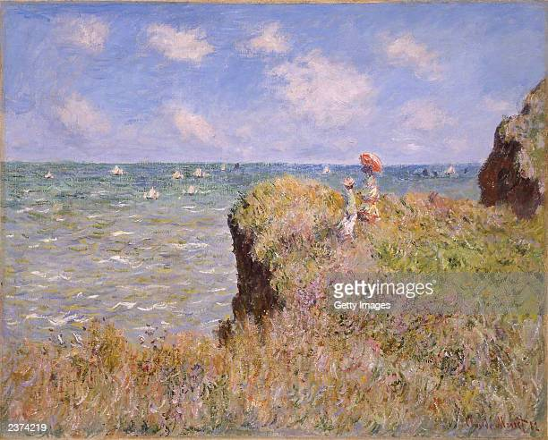 This handout photo from The National Gallery of Scotland shows a painting entitled 'Promenade on the Cliff at Pourville' by the artist Monet The...