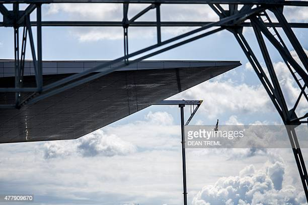 This handout photo received from Red Bull and taken on June 20 2015 shows Andy Jones of the USA diving from the 28 metre platform on the Copenhagen...