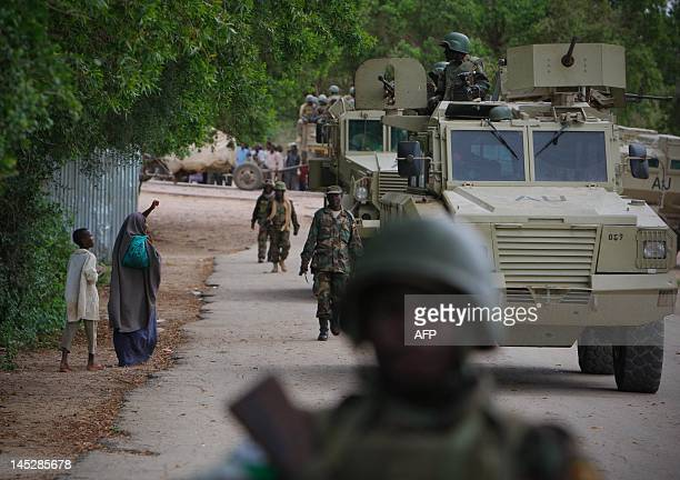 This handout photo released by the African UnionUnited Nations Information Support Team and taken on May 25 2012 shows a Somali woman waveing towards...