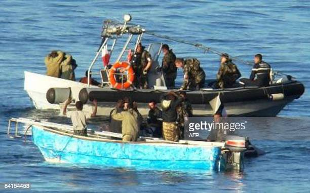 AVAILABLE This handout photo released by the French Ministry of Defense on January 1 2009 shows French soldiers arresting presumed Somali pirates in...