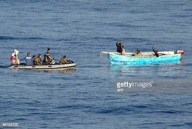 This handout photo released by the French Ministry of Defense on January 1 2009 shows French soldiers arresting presumed Somali pirates in the...