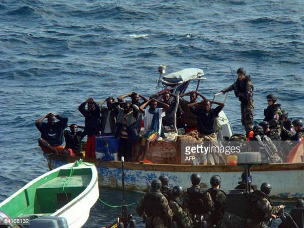 This handout photo released by the French Ministry of Defense on January 4 2009 shows French soldiers arresting presumed Somalian pirates in the Gulf...