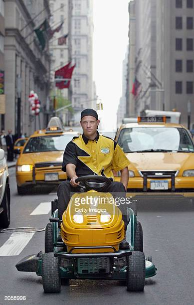 This handout photo shows Brad Hauter the 'YardMan' from Indiana motoring down Broadway on his YardMan lawnmower to New York's Battery Park where he...