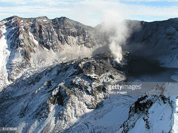This handout photo taken October 11 2004 by the US Geological Survey shows Mount St Helens' crater and dome as seen from the northwest Scientists are...