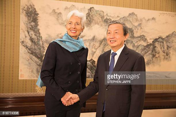 This handout photograph taken and released by the International Monetary Fund on March 21 2016 shows International Monetary Fund Managing Director...