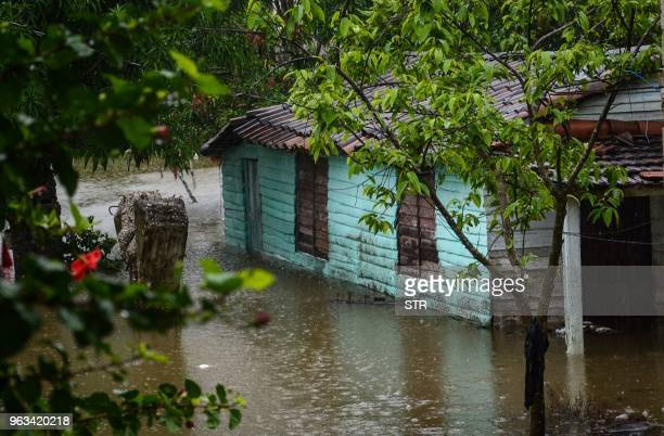 This handout picture released by the Cuban News Agency shows a flooded house in the city of Santa Clara Villa Clara province after heavy rains...