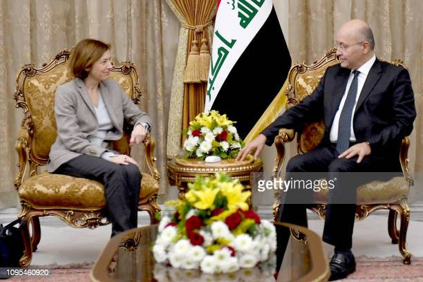 This handout picture released by the Iraqi presidency on February 08 shows French Defence Minister Florence Parly meeting Iraqi President Barham...