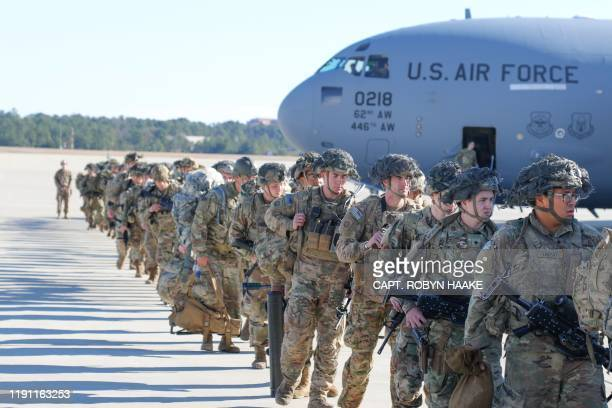 This handout picture released by the US Army shows U.S. Army Paratroopers assigned to the 2nd Battalion, 504th Parachute Infantry Regiment, 1st...