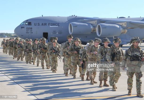 This handout picture released by the US Army shows US Army Paratroopers assigned to the 2nd Battalion 504th Parachute Infantry Regiment 1st Brigade...