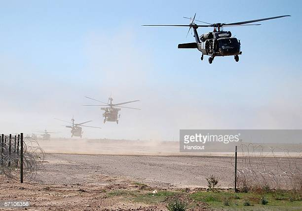 This handout picture released by U.S military on March 16 shows U.S. Helicopters taking off for Operation Swarmer March 16, 2006 at Forward Operating...