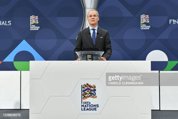 This handout picture taken and made available by the UEFA on December 3, 2020 shows UEFA competitions director Giorgio Marchetti introducing the 2021...