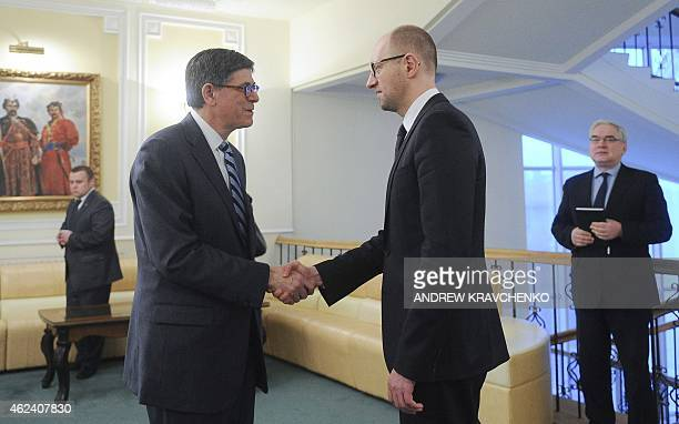 This handout picture taken and released by the Ukrainian Prime Minister's pressservice shows Prime Minister Arseniy Yatsenyuk welcoming US Treasury...