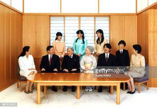 This handout picture taken by Imperial Household Agency on November 18, 2015 shows Japanese Emperor Akihito and Empress Michiko smiling with their...