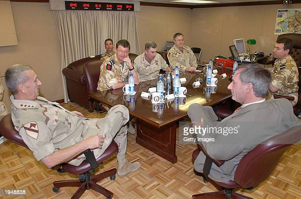 This hanout photo from Central Command shows U.S. General Tommy Franks meeting with British Defense Minister Geoff Hoon in his war room at Camp As...