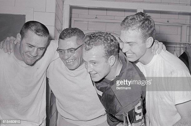 This happy foursome of Green Bay Packers are shown in dressing room after winning the Western Division Championship by defeating the New York Giants...
