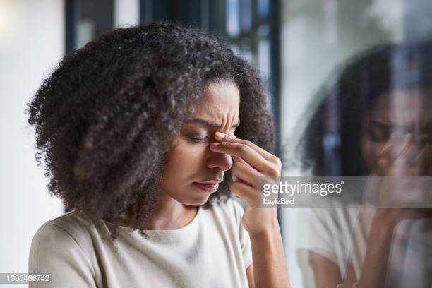 this headache is getting in the way of her work - headache stock pictures, royalty-free photos & images