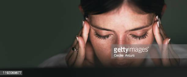 this headache is starting to worsen - headache stock pictures, royalty-free photos & images