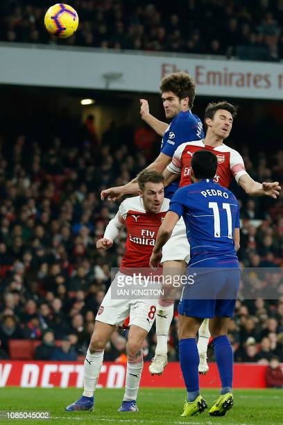 This header from Chelsea's Spanish defender Marcos Alonso comes back off the post during the English Premier League football match between Arsenal...