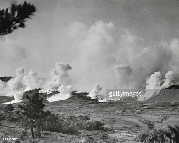 This hillside outside Naha, capitol of Okinawa, is covered with a pall of smoke, as first division Marines move forward under a smoke screen to knock...