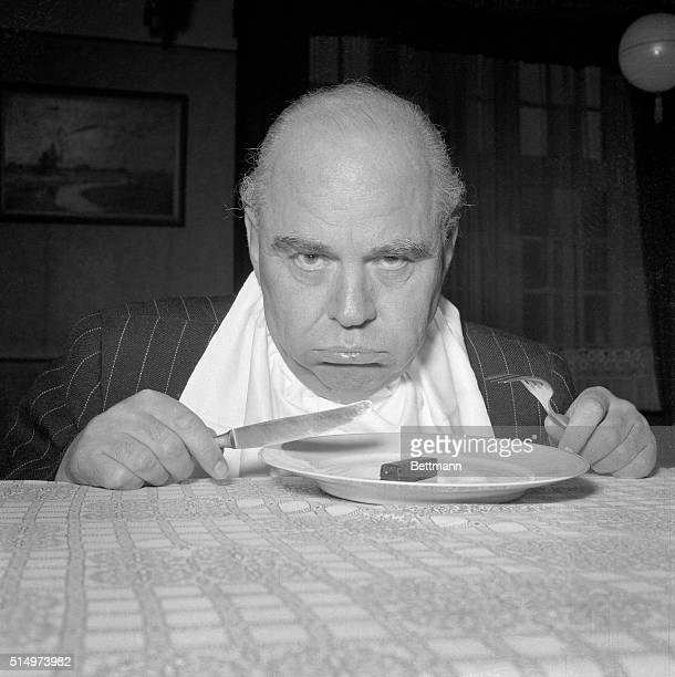 This hungry victim of his wife's campaign to attack his swelling waistline looks gloomily at the meal she has set before him The object is a...