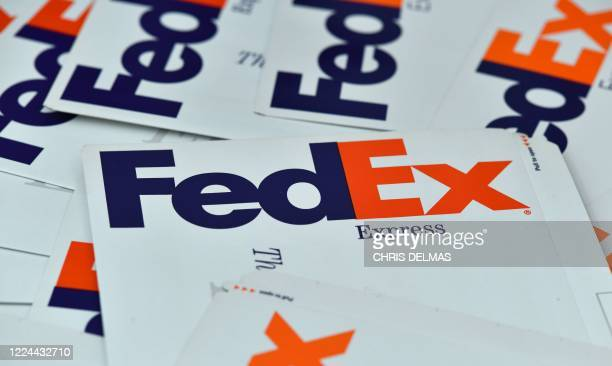 This illustration photo taken on July 2 2020 shows a Fedex envelope with the company logo in Los Angeles US delivery giant FedEx Corp is seeking to...