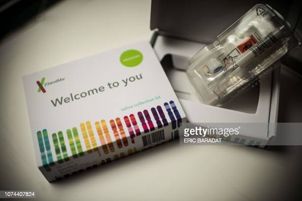 This illustration picture shows a saliva collection kit for DNA testing displayed in Washington DC on December 19, 2018. - Between 2015 and 2018,...