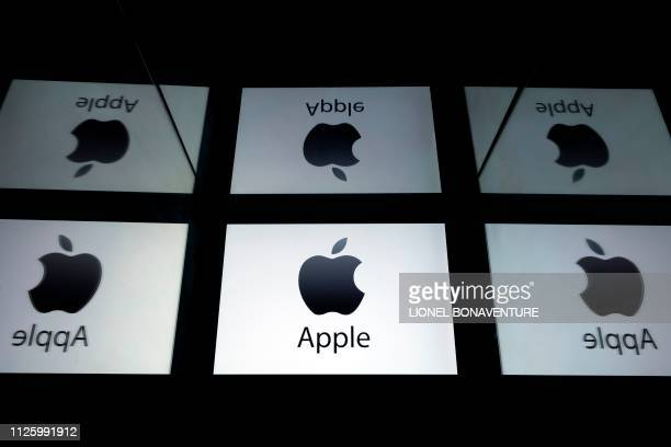This illustration picture shows the US multinational technology company Apple logo displayed on a tablet in Paris on February 18, 2019.