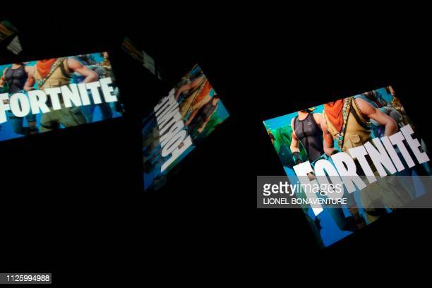 This illustration picture shows the video game Fortnite logo displayed on a tablet in Paris on February 18 2019