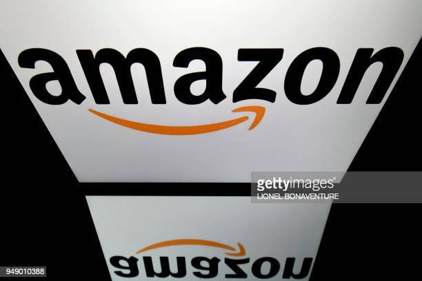 This illustration picture taken on April 19 2018 shows the logo of online retail comapny Amazon displayed on a tablet screen in Paris