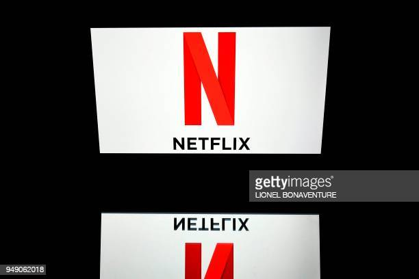 This illustration picture taken on April 19 2018 shows the logo of the Netflix entertainment company displayed on a tablet screen in Paris