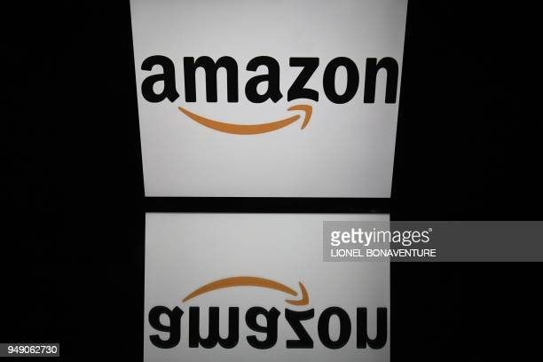 This illustration picture taken on April 19 2018 shows the logo of Amazon displayed on a tablet screen in Paris