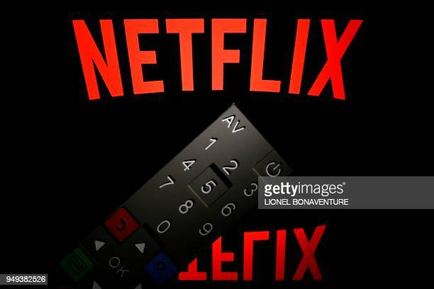This illustration picture taken on April 21 2018 in Paris shows the logo of the Netflix entertainment company displayed on a tablet screen with a...