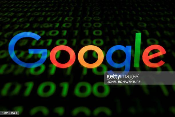 This illustration picture taken on April 29 shows the Google logo displayed on a screen and reflected on a tablet in Paris