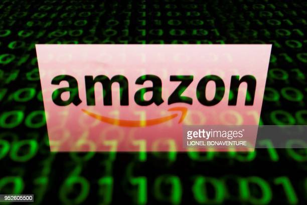 This illustration picture taken on April 29 shows the logo of Amazon displayed on a screen and reflected on a tablet in Paris