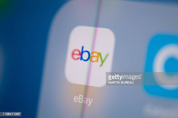 This illustration picture taken on July 24 2019 in Paris shows the logo of the US web auctions application Ebay on the screen of a tablet