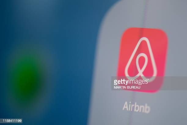 This illustration picture taken on July 24 2019 in Paris shows the logo of the US online booking homes application Airbnb on the screen of a tablet