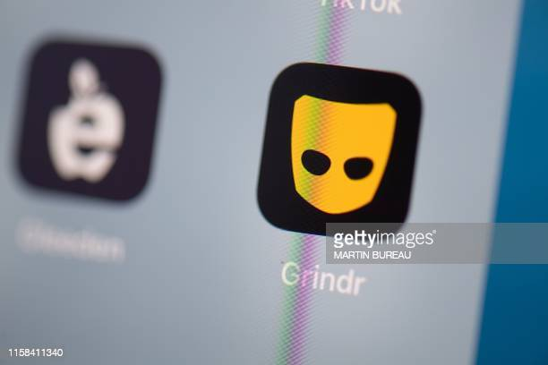 This illustration picture taken on July 24 2019 in Paris shows the logo of the US social networking application Grindr on the screen of a tablet
