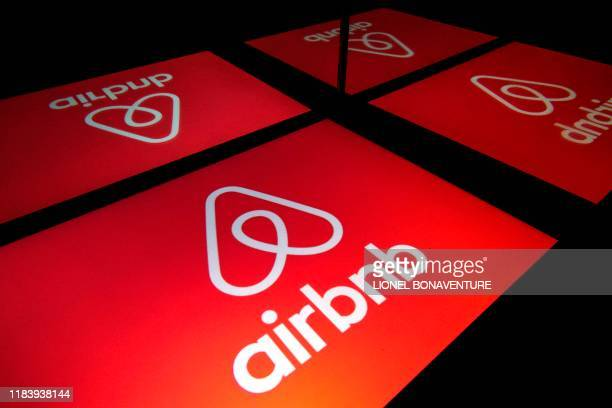 This illustration picture taken on November 22 shows the logo of the online lodging service Airbnb displayed on a tablet in Paris